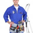 Full-length portrait of a handyman with his tools - Stock Photo