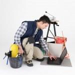 Tiler with equipment, studio shot — Stock Photo #11798304