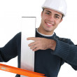 Stock Photo: Worker with spirit level