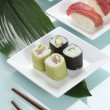 Stockfoto: Three plates of sushi