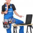 Female plumber surrounded by her equipment — Stock Photo