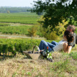 Couple having picnic in the vineyard - Stock Photo