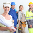 Stock Photo: Workers with one in foreground