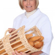 Mature woman baker on white background — Stock Photo