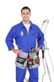 Full-length portrait of a handyman with his tools — Stock Photo