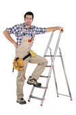 Handyman stood by step-ladder — Stock Photo