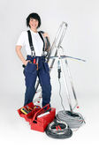 Female electrician stood by ladder — Stock Photo