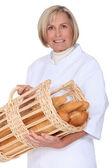 Baker de femme mature sur fond blanc — Photo