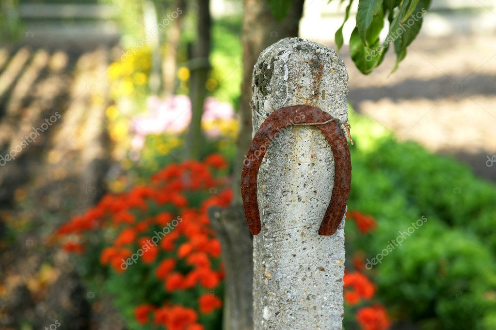 Horse shoe attached to stone post — Stock Photo #11798322