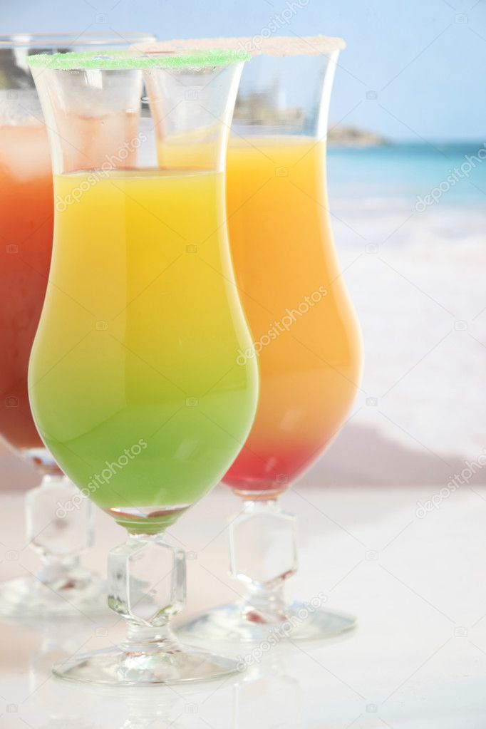 Three colorful cocktails on the beach — Stock Photo #11799513