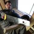 Carpenter using handsaw - Stock fotografie