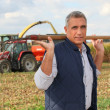 Farmer carrying pitchfork — Stock Photo #11800926