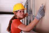 Woman installing wiring — Stock Photo