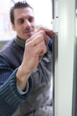 Man fitting double glazing — Stock Photo