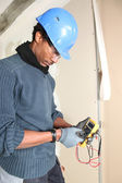 Safety conscious electrician — Stock Photo