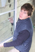 Joiner fixing window — Stock Photo