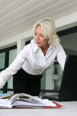 Senior businesswoman at her desk — Stock Photo