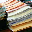 Paperwork piled on a desk — 图库照片