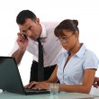 Business couple hard at work — Stock Photo #11810636