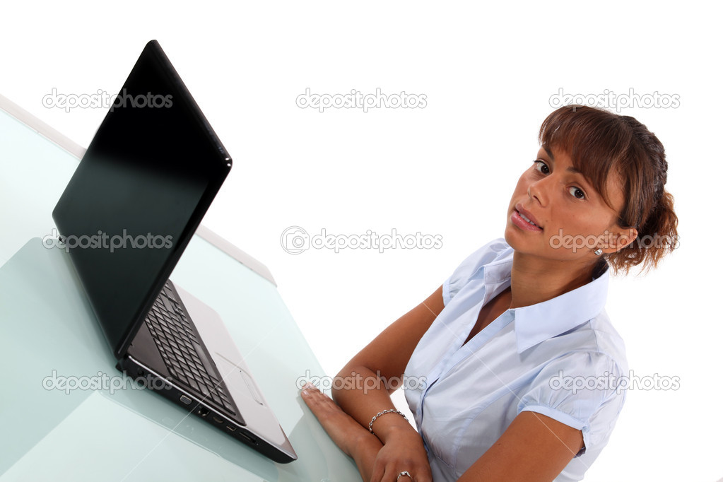 Woman using a laptop at a desk — Stock Photo #11810653