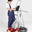 Female electrician working on her laptop — Stock Photo #11845714
