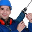 Tradesmholding up electric screwdriver — Stock Photo #11845716