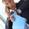 Shocked businessman realizing he is late - Stock Photo