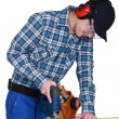 Woodworker using jigsaw — Stock Photo #11845877