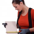 Tradeswoman measuring a tile — Stock Photo #11845940
