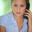 Blond receptionist taking a call — Stock Photo #11845955
