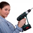 Woman holding drill on white background — Stock Photo #11845972