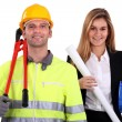 Portrait of fine-looking female architect and workman - Stock Photo