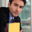 Office worker holding folders — Stock Photo #11846039