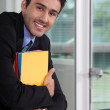 Smiling businessman holding files — Stock Photo #11846047