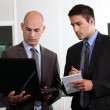 Duo of young businessmen with laptop — Stock Photo