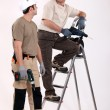 Two handymen at work. - Stock Photo