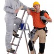 Electrician and decorator — Stock Photo