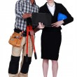 Architect and builder looking at a laptop - Stock Photo