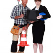 Businesswoman and road worker posing together — Stock Photo