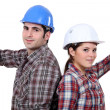 Stock Photo: A couple of carpenters back to back.
