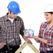 Builders with house made out of money — Stock Photo #11846137