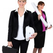An architect standing in front of her colleague — Stock Photo #11846210