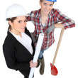 Blue collar worker standing next to an engineer — Stock Photo #11846275