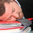 Stock Photo: Businessman asleep on his files