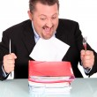 Man about to devour a pile of files — Stock Photo #11846294