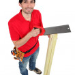 A carpenter sawing wood. — Stock Photo #11846373