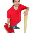 Man holding tool-box and wooden planks — Stock Photo #11846379