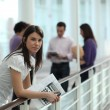 Female student in hallway — Stock Photo #11846396