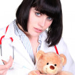 Doctor administering an injection to a teddy bear — Stock Photo