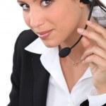 Woman wearing headset — Stock Photo